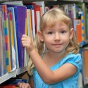 girl at bookshelf - education - suppliers and services - just kids - my sheen village
