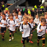 Ruggerbeez running out onto the pitch - parties - just kids - my sheen village